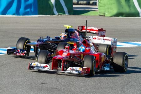 f1: JEREZ DE LA FRONTERA, SPAIN - FEB 09: Fernando Alonso of Scuderia Ferrari F1 followed by Jean Eric Vergne of Toro Rosso races on training session on February 09 , 2012, in Jerez de la Frontera , Spain Editorial