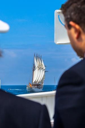 CADIZ, SPAIN - APR 01: Officers seeing the Spanish Navy Training Ship, Juan Sebastian de Elcano setting sail on the 83rd cruise of instruction with 69 midshipmen on April 01 , 2012, in Cadiz , Spain Stock Photo - 13111779
