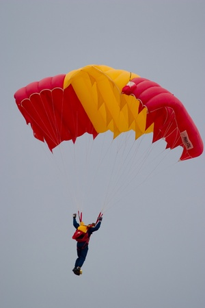 accomplishing: Parachutists, accomplishing a series of stunt flyings Editorial