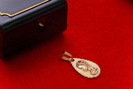 Precious gold pendant of the virgin girl, ideal to give  as a present for the young persons in the first communion Stock Photo - 13823056