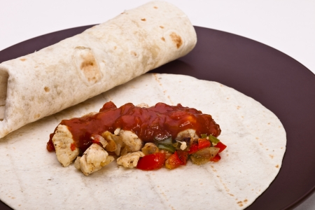 Burritos with chicken pepper onion garlic and sauce photo