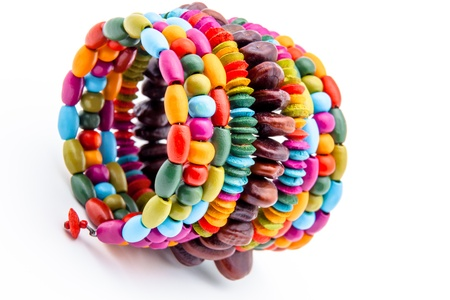 Colorful fashion bracelets on a white background photo