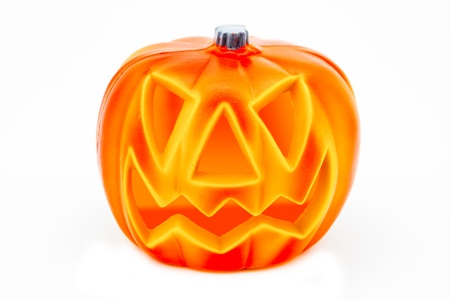 A scary Halloween pumpkin on a white background photo