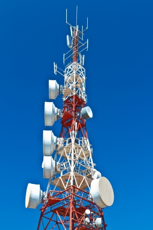 Communications tower with a beautiful blue sky photo