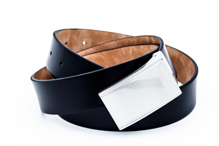 Leather black belt for men on a white background photo