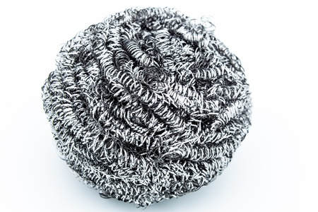 A steel wool dishwashing on a white background photo