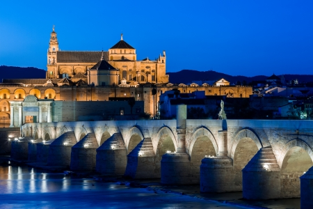 Cityscape of Cordoba at sunset with roman bridge and Mezquita, Andalusia, Spain