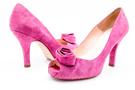 Pair of pink  dress women shoes isolated over white photo