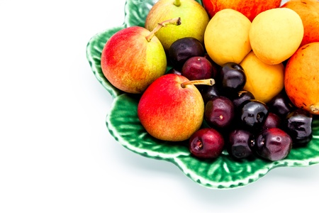 Variety of fresh fruit on a plate photo