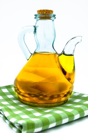 Olive oil on a oil jar on a white background photo