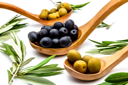 Olives and olives leaves on a white background photo