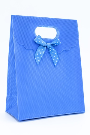Blue gift bag on a white background photo