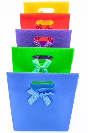 Lots of gift bags of different colors photo
