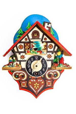 cuckoo clock: Un reloj de cuco poco sobre un fondo blanco Foto de archivo