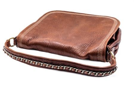 leathern: A leathern handbag on a white background