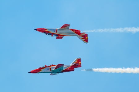 maneuver: CADIZ, SPAIN-SEP 14: Aircrafts of the Patrulla Aguila taking part in a exhibition on the 1st airshow of Cadiz on Sep 14, 2008, in Cadiz, Spain