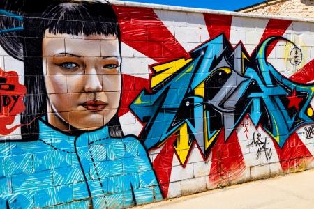 slums: PUERTO REAL, CADIZ, SPAIN-JUL 15: Graffiti of unidentified artist on the first tournament of Graffiti of Puerto Real on Jul 15, 2011, in Puerto Real,  Spain