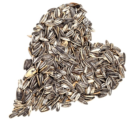 sunflowerseed: A heart made by lot of sunflower seeds Stock Photo