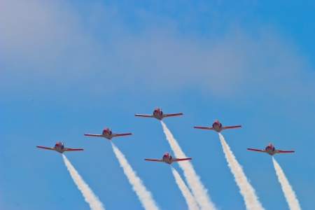 SAN FERNANDO, SPAIN-SEP 24: Aircrafts of the Patrulla Aguila taking part in an exhibition on the commemoration of day of the first Spanish constitution of 1810  on SEP 24, 2005, in San Fernando, Spain Stock Photo - 17228217