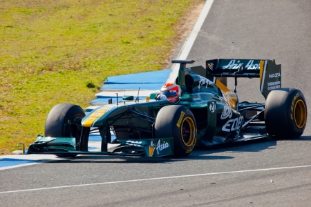 JEREZ DE LA FRONTERA, SPAIN - FEB 10: Jarno Trulli of Team Lotus F1 races on training session on February 10 , 2011, in Jerez de la Frontera , Spain Stock Photo - 17228291