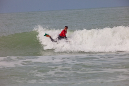 SAN FERNANDO, CADIZ, SPAIN - FEB 19: Unidentified bodyboader taking waves on the 2nd championship of Surf and BodyBoard Impoxibol on Feb 19,2011 on the beach of Camposoto of San Fernando, Cadiz, Spain