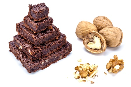One pyramid of brownies with walnuts on a white background photo