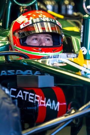 jarno: JEREZ DE LA FRONTERA, SPAIN - FEB 10: Jarno Trulli of Catherham F1 waiting on pit on training session on February 10 , 2012, in Jerez de la Frontera , Spain Editorial