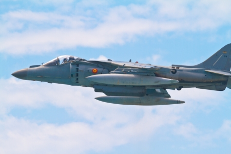 aviators: MALAGA, SPAIN-MAY 28: Aircraft AV-8B Harrier Plus taking part in an exhibition on the day of the spanish army forces on May 28, 2011, in Malaga, Spain Editorial