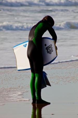bodyboard: SAN FERNANDO, CADIZ, SPAIN - FEB 19: Unidentified bodyboader leaving the water on the 2nd championship of Surf and BodyBoard Impoxibol on Feb 19,2011 on the beach of San Fernando, Cadiz, Spain