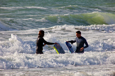 bodyboarding: SAN FERNANDO, CADIZ, SPAIN - FEB 19: Unidentified bodyboaders leaving the water on the 2nd championship of Surf and BodyBoard Impoxibol on Feb 19,2011 on the beach of San Fernando, Cadiz, Spain