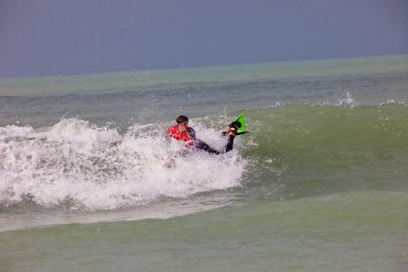 bodyboard: SAN FERNANDO, CADIZ, SPAIN - FEB 19: Unidentified bodyboader taking waves on the 2nd championship of Surf and BodyBoard Impoxibol on Feb 19,2011 on the beach of Camposoto of San Fernando, Cadiz, Spain Editorial