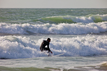 bodyboard: SAN FERNANDO, CADIZ, SPAIN - FEB 19: Unidentified surfer taking waves on the 2nd championship of Surf and BodyBoard Impoxibol on Feb 19,2011 on the beach of Camposoto of San Fernando, Cadiz, Spain Editorial