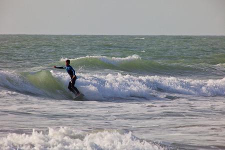 bodyboarder: SAN FERNANDO, CADIZ, SPAIN - FEB 19: Unidentified surfer taking waves on the 2nd championship of Surf and BodyBoard Impoxibol on Feb 19,2011 on the beach of Camposoto of San Fernando, Cadiz, Spain Editorial