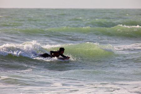 bodyboarder: SAN FERNANDO, CADIZ, SPAIN - FEB 19: Unidentified bodyboader taking waves on the 2nd championship of Surf and BodyBoard Impoxibol on Feb 19,2011 on the beach of Camposoto of San Fernando, Cadiz, Spain Editorial