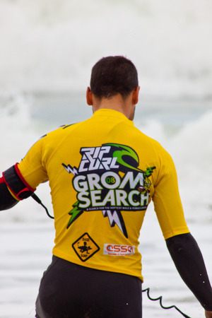 bodyboarding: SAN FERNANDO, CADIZ, SPAIN - FEB 19: Unidentified bodyboader going to the water on the 2nd championship of Surf and BodyBoard Impoxibol on Feb 19,2011 on the beach of Camposoto of San Fernando, Cadiz, Spain Editorial