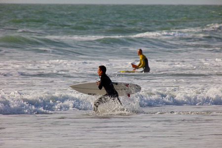 bodyboarding: SAN FERNANDO, CADIZ, SPAIN - FEB 19: Unidentified surfer going to the water on the 2nd championship of Surf and BodyBoard Impoxibol on Feb 19,2011 on the beach of Camposoto of San Fernando, Cadiz, Spain