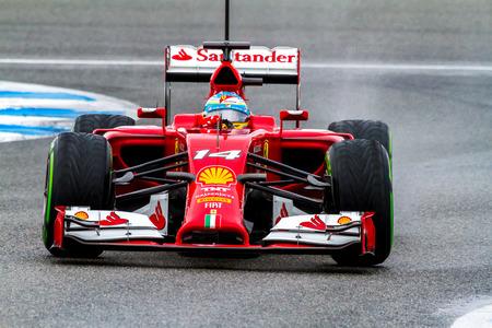 scuderia: JEREZ DE LA FRONTERA, SPAIN - JAN 31: Fernando Alonso of Scuderia Ferrari F1 races on training session on January 31 , 2014, in Jerez de la Frontera , Spain Editorial