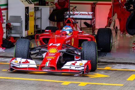 scuderia: JEREZ DE LA FRONTERA, SPAIN - JAN 31: Fernando Alonso of Scuderia Ferrari F1 leaving the pit on training session on January 31 , 2014, in Jerez de la Frontera , Spain Editorial