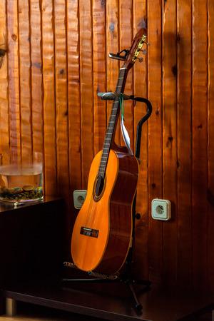 spanish guitar: Classic spanish guitar  near of a wood wall