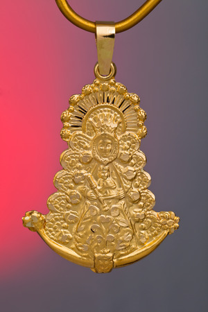 virgin girl: A Precious gold pendant, ideal like gift Stock Photo