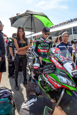 motobike: JEREZ DE LA FRONTERA - OCTOBER 16, 2016: World Superbike Race Jonathan Rea, Kawasaki Racing Team, 1, with a beautiful grid girl