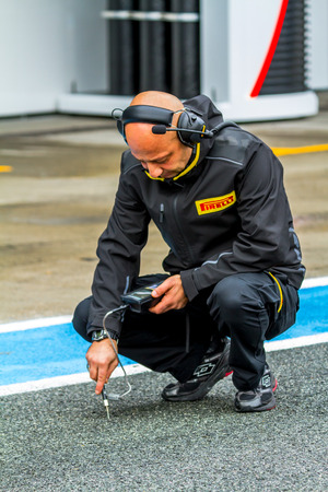 JEREZ DE LA FRONTERA, SPAIN - FEB 03: Pirelli engineer on pits on training session on February 03, 2015 in Jerez de la Frontera , Spain
