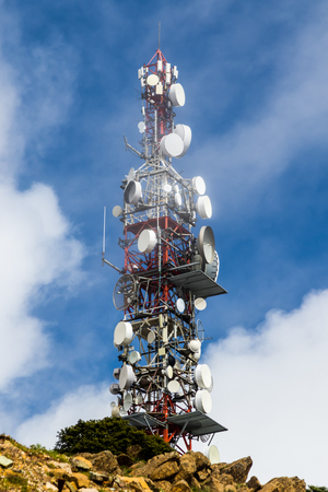 Big communications tower in a foggy day on Estepona, Malaga, Spain Stock Photo