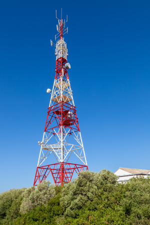 Communications tower with a beautiful blue sky on Puerto Real, Cadiz, Spain Stock Photo
