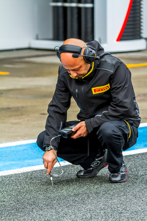 JEREZ DE LA FRONTERA, SPAIN - FEB 03: Pirelli engineer on pits on training session on February 03, 2015 in Jerez de la Frontera , Spain