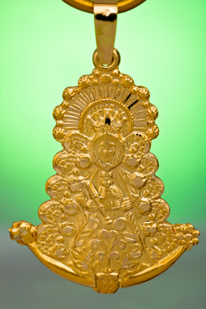 personal ornaments: A Precious gold pendant, ideal like gift Stock Photo