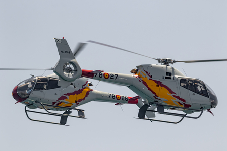 TORRE DEL MAR, MALAGA, SPAIN-JUL 30: Patrulla Aspa, Helicopter Eurocopter EC-120 Colibri taking part in a exhibition on the 2nd airshow of Torre del Mar on July 30, 2017, in Torre del Mar, Malaga, Spain