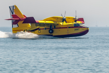 TORRE DEL MAR, MALAGA, SPAIN-JUL 28: Seaplane Canadair CL-215  taking part in a exhibition on the 2nd airshow of Torre del Mar on July 28, 2017, in Torre del Mar, Malaga, Spain Editorial