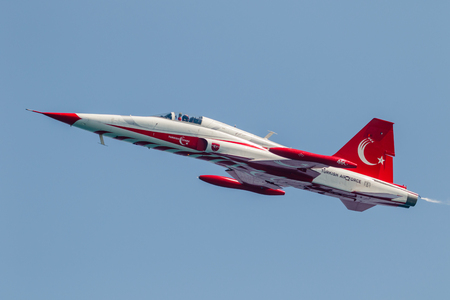 pilotos aviadores: TORRE DEL MAR, MALAGA, SPAIN-JUL 28: Aircraft Northrop F-5 of the Turkish Stars  taking part in a exhibition on the 2nd airshow of Torre del Mar on July 28, 2017, in Torre del Mar, Malaga, Spain