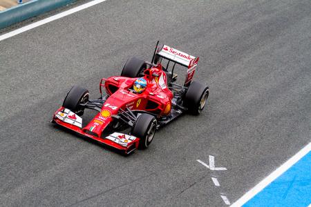 turn of the year: JEREZ DE LA FRONTERA, SPAIN - JAN 31: Fernando Alonso of Scuderia Ferrari F1 leaving the pit on training session on January 31 , 2014, in Jerez de la Frontera , Spain Editorial